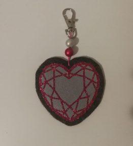 Hohtava laukkukoru timantti sydän harmaa-pinkki