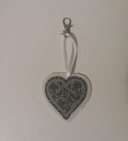 Hohtava laukkukoru sydän valko-hopea