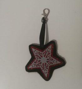 Hohtava laukkukoru tähti puna-musta