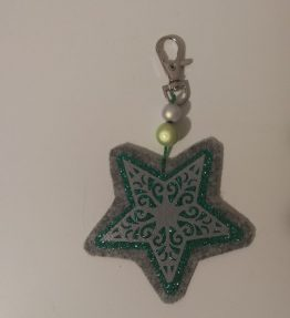 Hohtava laukkukoru tähti vihreä-harmaa